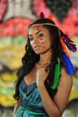 Beautiful indian cherokee woman with feathers — Stockfoto