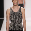 Stock Photo: Model walks runway wearing Mister Triple X