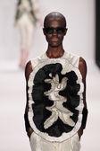 Model walks runway wearing Nino Lettieri — Stock Photo