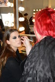 Model getting ready backstage at Leka show — Stock Photo