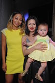 Designers Kelly Mi Lee and Aida with baby — Stok fotoğraf