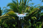 Quadcopter with mounted video camera — Stock Photo