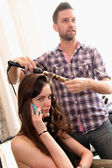 Hair stylist getting model ready backstage — 图库照片