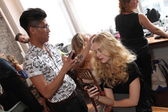 Hair stylist getting model ready backstage — Photo