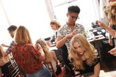 Hair stylist getting model ready backstage — Zdjęcie stockowe