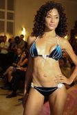 Model walks runway for Karo Swimwear collection — Stock Photo