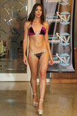 Model walks runway for Karo Swimwear collection — Stock Photo