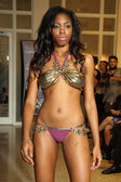 Model walks runway for Karo Swimwear collection — Photo