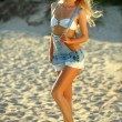 Blond model posing at the beach — Stock Photo #49899587
