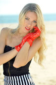 Blond woman on the beach — Stock Photo
