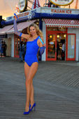 Model in swimsuit posing on boardwalk — Stock Photo