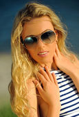 Girl at the beach  in summer time — Stockfoto