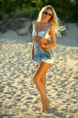 Blond model posing at the beach — Stock Photo