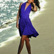 Model in dress walking on the beach — Stock Photo #50813205