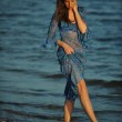 Woman posing on the beach in dress — Stock Photo #50813563