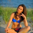 Woman in blue swimsuit on the beach — Stock Photo #50813869