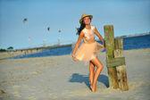 Woman in luxury dress and hat — Stok fotoğraf