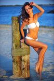 Model on the beach in white bikini — Stock Photo