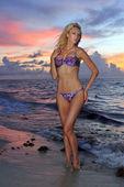 Model posing in bikini at early morning sunrise — Stock Photo