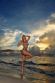 Model posing in bikini at early morning sunrise — Stock Photo