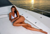 Woman with slim body laying on yacht — Stock Photo