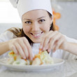 Beautiful brunette cooking in the kitchen — Stock Photo #12450842
