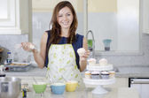 Beautiful brunette cooking in the kitchen — Stock Photo