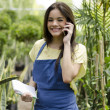 Cute female florist taking an order from a customer - Stockfoto