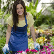 Cute young gardener at work — Stock Photo