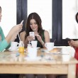 Young women centered around cell phones — Stock Photo #15811129