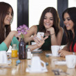 Young women centered around cell phones — Stock Photo #15810749