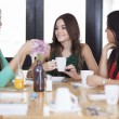 Beautiful women drinking coffee - Stock Photo