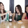 Three women drinking champagne — Stock Photo