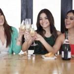 Three women drinking champagne — Stock Photo #15811795