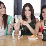 Three women drinking champagne — Stock Photo #15811801