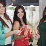 Three women drinking champagne — Stock Photo #15811869