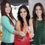 Three women drinking champagne — Stock Photo #15811907
