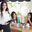 Stock Photo: Portrait of young waitress and customers
