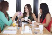 Beautiful women drinking coffee — Stock Photo
