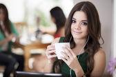 Beautiful Girl Drinking Tea or Coffee — Stock Photo
