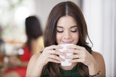 Beautiful young woman with cup of coffee — Stock Photo