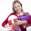Young woman holding heart shaped gift — Stock Photo