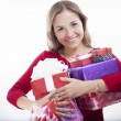 Young woman holding heart shaped gift — Stock Photo #18194447