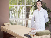 Handsome therapist in the massage room — Stock Photo