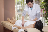 Therapist makes massage — Stock Photo