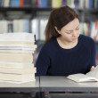 Woman reading at the library — Stock Photo #22155167