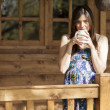 Girl drinking tea on veranda — Stock Photo #22156433