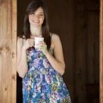 Girl drinking tea on veranda — Stock Photo #22156455