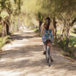 Young girl having riding their bicycles - Stock Photo