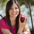 Portrait of a young beautiful girl with red apple — Stock Photo